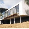 Maison bois modulaire, maison bois ronde, maison bois sur pilotis plan construction constructeur